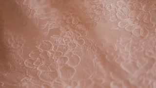 Close up of wedding cloth with lace. Wedding preparation. Wedding dress on hanger