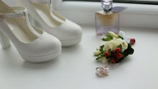 Close up white bridal shoes. Bride wedding accessories. White wedding shoes on high heels. Woman high heels