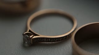 Golden wedding rings with diamonds. Close focus on wedding rings on white background. Very close up shot