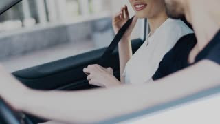 Happy young hipster couple dancing and singing like crazy in car driving