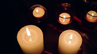 View from top at burning candles on dark background