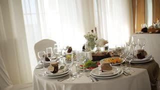 White wedding decor at restaurant with all beauty and flowers