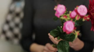 Woman holding flowers in her hands.