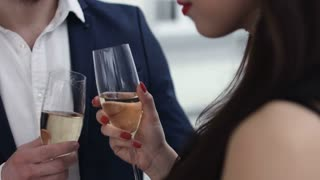 Young Couple Toasting champagne In Restaurant. Dating. Young man and woman on romantic dinner drinking at restaurant, celebrating valentine day.