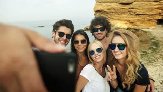 Young friends taking selfie on the beach.
