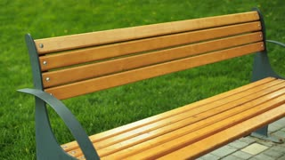 Young funny woman sitting on a bench and relaxing after long running distance.