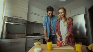 Young lady making breakfast for her man.