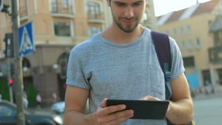 Young man using his tablet.