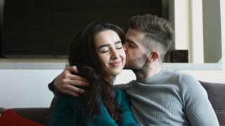 Young woman and her attractive handsome boyfriend resting at home together.