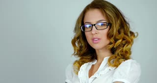 Young woman model in glasses poses on camera  close-up shot.