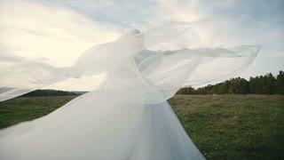 Bride's bridal veil blowing in the wind 2