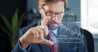 Stock Trader Holds Hologram Pad