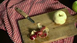 Apple peel. Peeling apple. Hands cut peel apple. Vegan food. Vegetarian food. Process cutting peel of fresh apple. Ingredients to baking apple cake. Healthy food. Peeling apple with knife for peeling