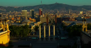 Barcelona landmarks. Timelapse of towers on square in center of Barcelona city. Plaza de Espana. Travel landmarks in Spain. Panorama view of Barcelona downtown at sunrise. European city sunrise