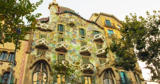BARCELONA, SPAIN - JUNE 3, 2016: Casa Batllo exterior at sunset. Casa Batllo building was built in 1877 by Antoni Gaudi. Timelapse of House of bones - one of travel landmarks in Europe