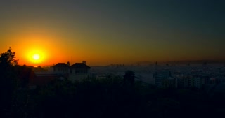 Barcelona sunrise timelapse. View of city from Montjuic. Time lapse of summer sunrise at city. Timelapse of sunrise in Barcelona city, Spain. Cloudless sky. Barcelona skyline. City panorama at morning