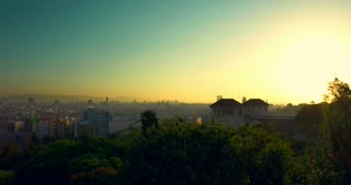 Barcelona sunset timelapse. View of city from Montjuic. Timelapse of sunset in Barcelona city, Spain. Cloudless sky. Time lapse of summer sun set at town. Barcelona skyline. City panorama at sunset