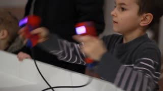 Boy boxing with gamepad in hands. Kid remote controlling robot. Boy fighting with controller game. Boy using gaming controller. Boy playing remote control toy