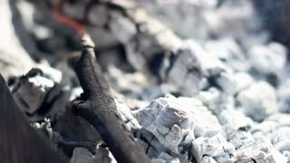 Charcoal. Burning charcoal. Closeup. Preparing wood ember for barbecue grill. Fire from ash and embers. Background. Smoke from hot charcoal. Smoldering coals. Barbecue fire. White charcoal. Wood coal