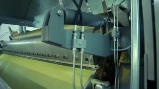 Cheese production line at food processing plant. Cheese manufacturing line. Production of food products. Industrial equipment at dairy factory