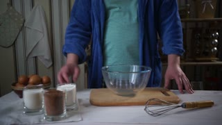 Chef cooking. Man add ingredients for chocolate cake into glass bowl. Cooking food. Man add flour into glass bowl. Homemade food. Baking ingredients. Cake ingredients