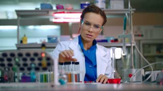 Chemist in lab. Chemical engineering. Female chemist working with chemical liquid in research lab. Woman chemist analyzing chemical reagents in laboratory. Woman scientist conducting chemical research