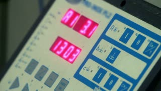 Closeup of control panel of equipment at dairy factory. Led display on industrial equipment. Digital display. Engineer equipment. Programmable equipment in a manufacturing plant