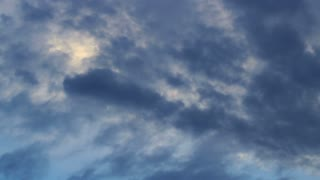 Clouds sky. Dark blue sky with white clouds. Panorama of white and grey clouds on sky. Natural sunlight on cloudy sky. Outdoor panorama on rainy dark clouds. Dark sky view. Cloudy sky. Dark clouds