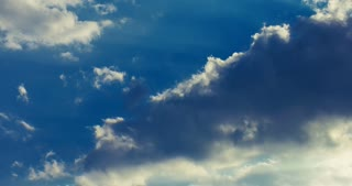 Clouds timelapse. Beautiful cloudscape. Clouds rolling on sky. Clouds sky. White clouds on blue sky. Sunlight in clouds. Clouds running fast on blue sky in a sunny day
