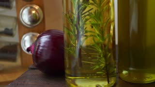 Cooking oil bottle. Cooking oils in glass bottles. Condiment bottles. Food ingredients of italian cuisine. Rosemary herb in olive oil. Kitchen herbs. Panning on italian food cooking ingredients