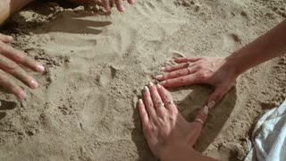 Couple hands forming heart shape from sand. Love symbol. Honeymoon vacation. Hands forming heart in sand. Love couple having fun on beach. Beach holiday. Love couple hands. Heart sand