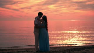 Couple kissing at sunset. Couple beach sunset. Kissing silhouette. Love couple sunset. Love couple at sea sunset. Silhouette couple kissing at golden sunset. Kissing couple. Love couple kissing.