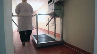 Employee of the industrial plant passes through the tripod turnstile. Factory entrance