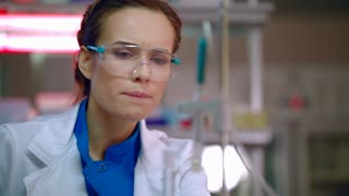 Female researcher preparing for lab research. Closeup of laboratory researcher working. Lab researcher in research laboratory. Science woman prepare for experiment. Lab worker face