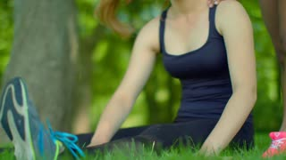 Fit girl stretching in park. Closeup of blonde woman expressing negative emotion while doing stretching exercises outdoor. Sport woman warm up muscles before fitness workout