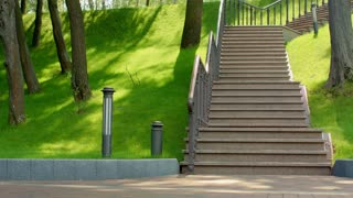 Fitness girl running up stairs in slow motion. Female runner jogging up stairs with dumbbells at park. Step up. Real woman running on staircase. Young woman fitness workout. Weight loss exercise