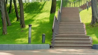 Fitness man running down stairs in slow motion. Healthy lifestyle concept. Athletic man run down stairs with dumbbells. Sporty man fitness workout. Young man in sport clothes. Fitness training in park