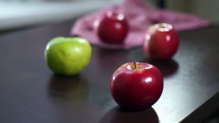 Fresh apples on wooden table. Red and green apples. Be different. Big beautiful fruit on table. Organic fresh apples. Apple juice fruits. Vegetarian food. Fresh fruits