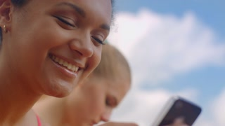 Happy woman. Woman smiling. Smiling face on sky background. Latin woman face. Closeup of african girl reading message on smartphone. Young woman smiling. Smiling happy woman. Smile on woman face