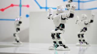 Humanoid robot dance. Group of cute robots dancing. Close up of smart robot dance show. Dancing robot performance. Robotic dance party. Smart robotic technology