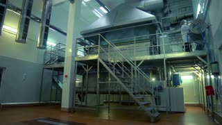 In production department in dairy. Food processing plant. Food industry. Production of food. Worker at dairy factory. Manufacturing line at food factory