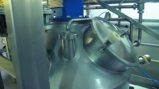 Industrial equipment at dairy factory. Production of cheese. Food production. Manufacture of dairy products. Food processing plant