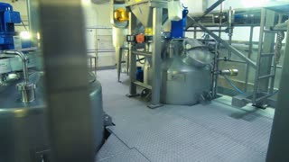 Interior of modern dairy factory. Milk tanks. Food processing equipment at factory. Food processing plant. Production of dairy products