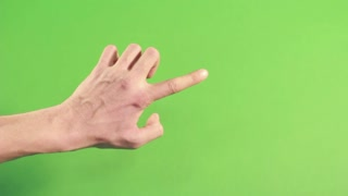 Isolated hand on green screen. Man hand on background. Forefinger pointing in studio on chroma key. Left hand on green background making gesture
