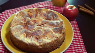 Knife slicing piece of cake. Slicing freshly baked apple pie with sharp kitchen knife. Piece of fresh apple pie with a golden crust. Ready apple pie. Autumn dessert. Sweet food