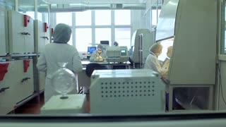 Laboratory people. Scientists working in chemistry laboratory. Biologists team working in laboratory. Modern science laboratory. Researchers working with laboratory equipment. Scientific research