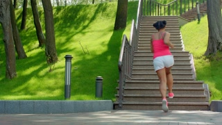 Latin woman run upstairs. Real woman running up stairs. Weight loss exercise. African woman running up staircase. Young woman climbing up stairs. Fitness training. Healthy lifestyle