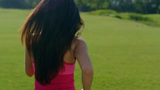Long hair woman running in park. Back of running woman in slow motion. Close up of woman running away outdoors. Running woman with long hair. Fit girl run outdoors. Sport girl run at morning