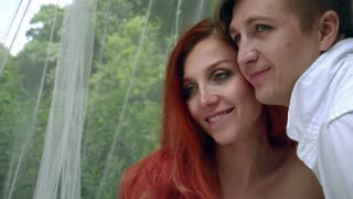 Love couple portrait outdoor. Close up of romantic couple posing for photo. Happy couple in love looking away. Closeup faces of man and redhead woman. Relationships concept