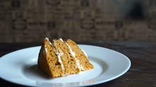 Man eating sweet pie. Sweet dessert eating. Unhealthy breakfast. Cake slice plate. Carrot cake piece eating. Carrot pie eat. Piece of cake eating. Piece pie eat. Tasty dessert dish